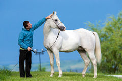 Man and white horse Stock Photos