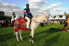 Man on white horse. Horse racing for children's entertainment and fun moments Stock Photo