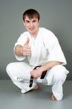 Man in white karate suit Royalty Free Stock Photos