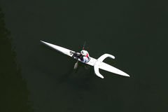 Man in white kayak with pontoons from above Stock Photo