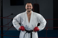 Man In White Kimono And Black Belt Training Karate Royalty Free Stock Image