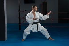Man In White Kimono And Black Belt Training Karate Stock Photo