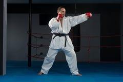 Man In White Kimono And Black Belt Training Karate Royalty Free Stock Images
