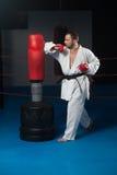 Man In White Kimono And Black Belt Training Karate Stock Photography