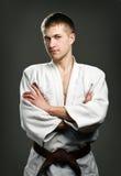 Man in a white kimono. On a gray background Royalty Free Stock Image