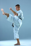 Man in white kimono training karate Stock Photography