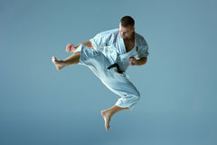 Man in white kimono training karate Stock Images