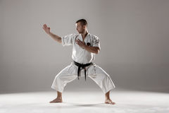 Man in white kimono training karate Royalty Free Stock Images