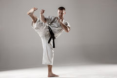Man in white kimono training karate Stock Photos