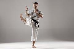 Man in white kimono training karate Stock Image