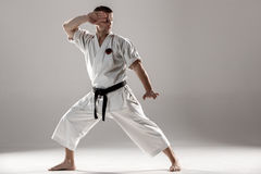 Man in white kimono training karate Royalty Free Stock Photography