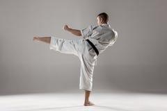 Man in white kimono training karate Stock Photos