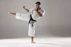 Man in white kimono training karate Royalty Free Stock Photo