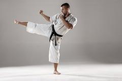 Man in white kimono training karate Royalty Free Stock Photo