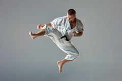 Man in white kimono training karate Stock Image