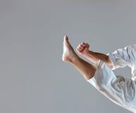 Man in white kimono training karate Royalty Free Stock Photos
