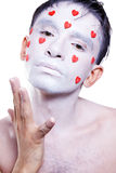 Man with white makeup and red hearts Royalty Free Stock Photos