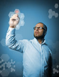 Man in white is marking. Virtual button. Innovative technology c Royalty Free Stock Photo