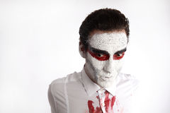 Man with white mascara and bloody shirt Royalty Free Stock Photos