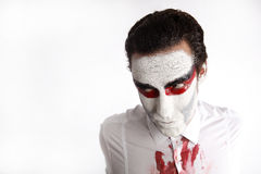 Man with white mascara and bloody shirt Royalty Free Stock Photo