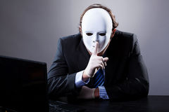 Man in white mask Stock Photo
