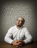 Man in white and maze. Man in thoughts. Man in white solving maze. Maze concept Stock Images