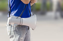 Man with white megaphone Stock Images
