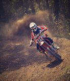 Man in White and Orange Motocross Overall Riding His Motocross Dirt Bike during Daytime Stock Photos