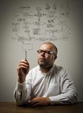 Man in white and plan Royalty Free Stock Image
