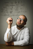 Man in white and plan Stock Images
