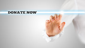 Man in White Pointing Glowing Donate Now Texts Stock Photos