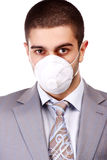 Man in white respirator Stock Images