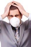 Man in white respirator Stock Photo