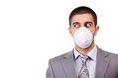 Man in white respirator Royalty Free Stock Image