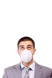 Man in white respirator Stock Photo