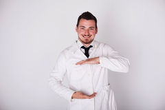 Man in a white robe Stock Images