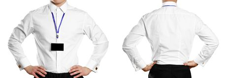 A man in a white shirt with a badge. Front and back. Close up. Isolated on white background.  royalty free stock image