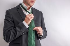 Man in white shirt and black suit get dressed / undressed. royalty free stock images