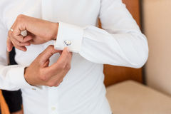 Man and white shirt and cufflink Royalty Free Stock Image