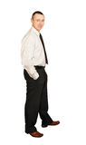 Man in a white shirt and dark pants Royalty Free Stock Photography