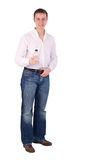 A man in white shirt with an empty bottle Royalty Free Stock Photography