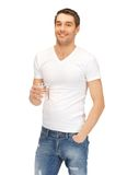 Man in white shirt with glass of water Stock Photo
