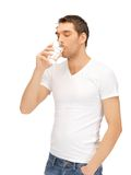 Man in white shirt with glass of water Royalty Free Stock Photography