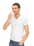 Man in white shirt with glass of water Stock Photos