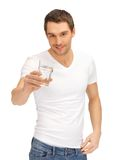 Man in white shirt with glass of water Royalty Free Stock Photo