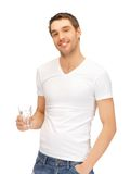 Man in white shirt with glass of water Royalty Free Stock Images