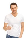 Man in white shirt with glass of water Stock Image