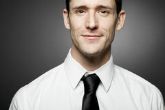 Man in white shirt on gray background. Stock Photos