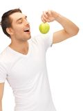 Man in white shirt with green apple Stock Photo
