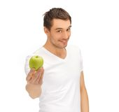 Man in white shirt with green apple Royalty Free Stock Image